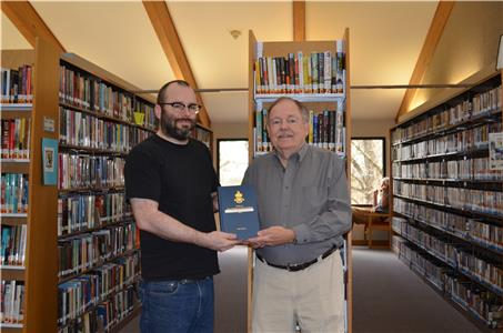 Jim Dodson, Vice President of the Signal Mountain Genealogical Society Presenting Book to Signal Mountain Assistant Librarian John Atkinson.