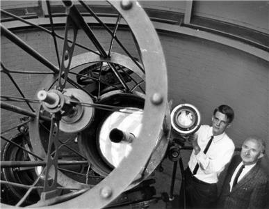 """Dr. Hal McAlister, then a student, with Dr. Karel Hujer, Associate Professor of Physics and Astronomy at UTC. They are standing with the 20.5"""" reflecting telescope of the Clarence T. Jones Observatory in Brainerd."""