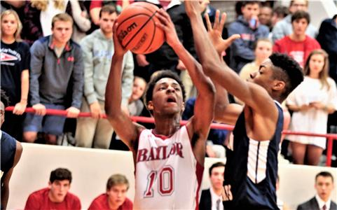 Beyman Hendricks (10) of Baylor tries to shoot over a Hamilton Heights defender Tuesday night at Baylor. Hendricks finished with a game-high 18 points.