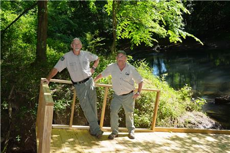 WMA manager Greg Atchley stands on one of the new ramps at the North Chickamauga Creek canoe launch alongside technician Fred Majors.