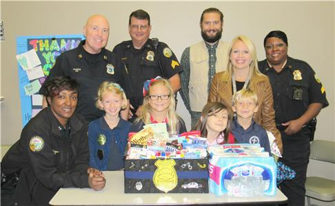 Pictured on the back row, from the Chattanooga Police department, are Capt. Jerri Sutton, Lt. Scott Fulgham, Sgt. John Luquer, Sgt. Philip McCall, Sgt. Willma Brooks. On the front row are BCA students, Edith McCall, Grace Tew, Lucy Sunderland, Mason Tew, and Kerri-Beth Tew, assistant director for the school's child care center.