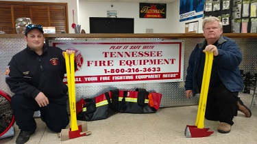 Mullins Cove Volunteer Fire Department Chief Vincent Vella and Marion County Local Planning Emergency Committee member Robert Payne show the axes bought with the Tennessee American Water Firefighting Support Grant.  The axes are useful in clearing brush during wildfires like the ones experienced in 2016.