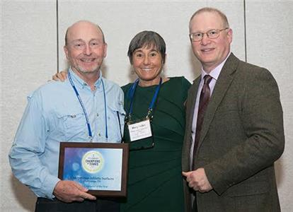 From left, Lee Murray, owner Competition Athletic Surfaces; Mary Helen Sprecher, Tennis Industry Magazine writer; and Peter Francesoni, managing editor, Tennis Industry Magazine