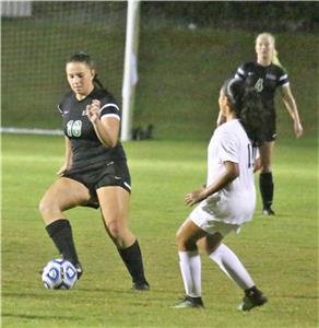 East Hamilton's Ashlyn Spake dribbles the ball during the region championship last week.  The Lady Hurricanes beat Anderson County this Saturday to qualify for the Class AA state tournament which begins on Wednesday in Murfreesboro.