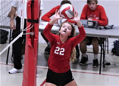 Baylor's Elaine Redman (22) sets up one of her 32 assists to help lead the Lady Red Raiders to a sweep (25-17, 25-13, 25-11) of Father Ryan on the Baylor campus Monday evening in a Division II-AA match. The win lifted Baylor's record to 27-4, 12-0, while the Lady Irish fell to 19-10, 9-3. Redman  added three aces, three kills and six digs to her totals.